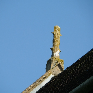 Ruined statuary on church roof.